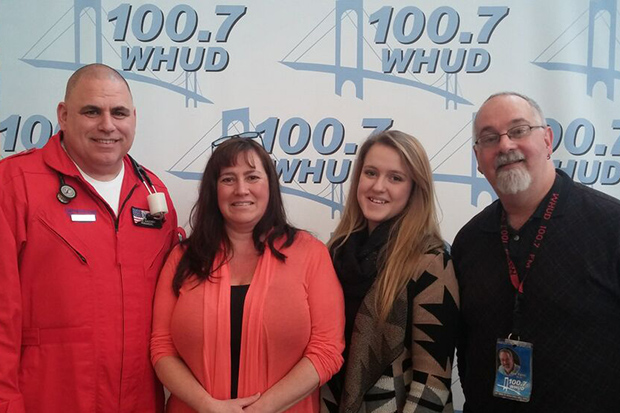 From left: John Mahoney, emergency medical technician; Cheryl Keator; Makaila Ouellette; and Tom Furci, 100.7 WHUD radio personality